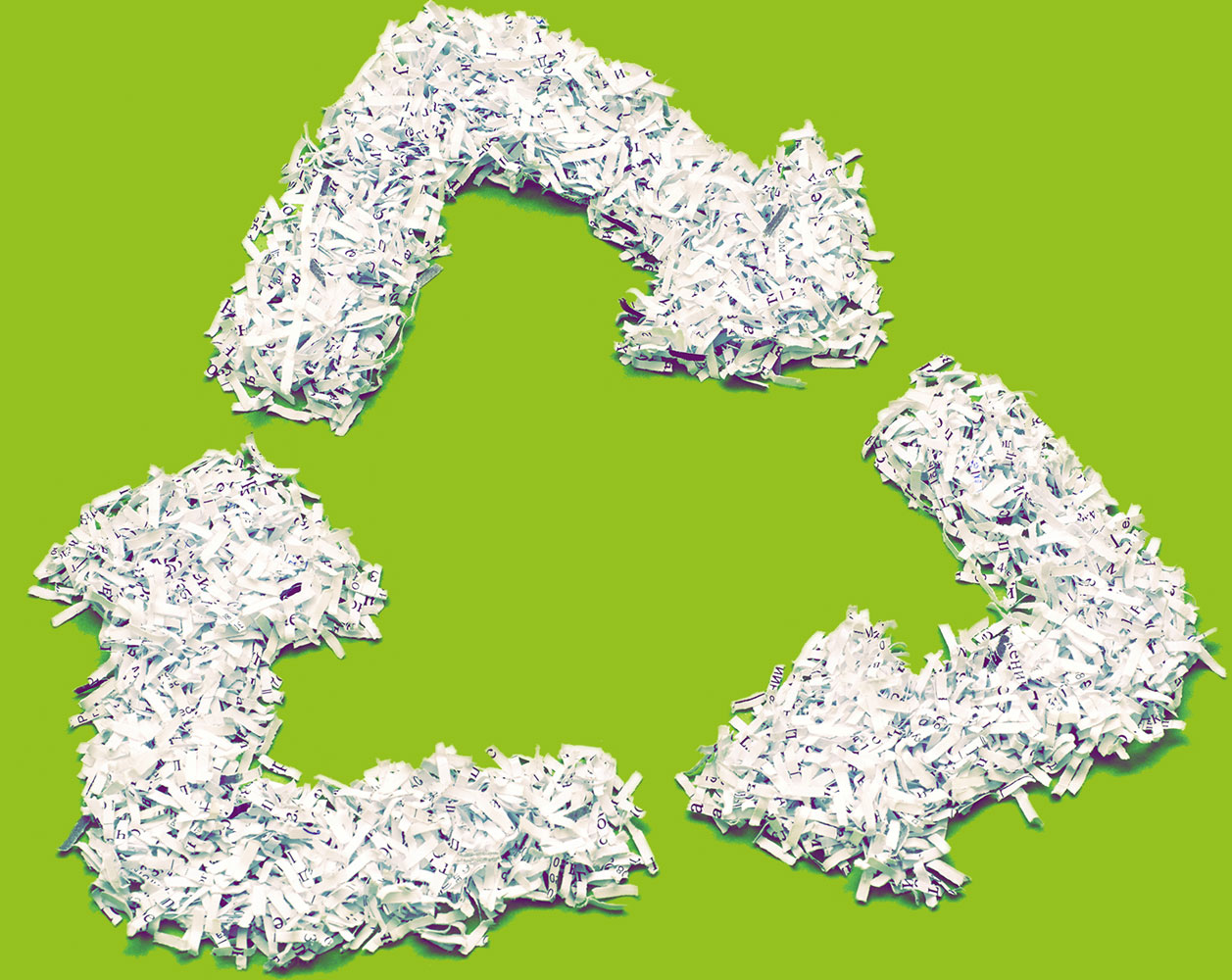 Recycling logo made out of shredded paper.
